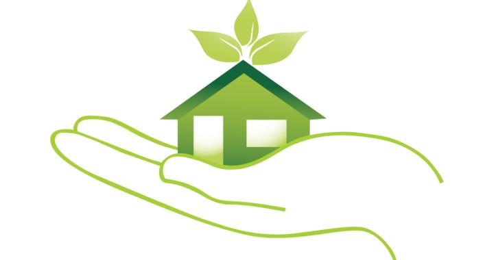 grønt hus på hånd